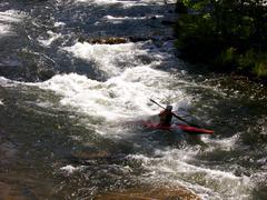Lone Kayaker Navigates Rapids.JPG Stock Photos
