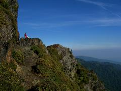 Lone Hiker atop Appalachian Mountain w/ Blue Sky.JPG - stock photo