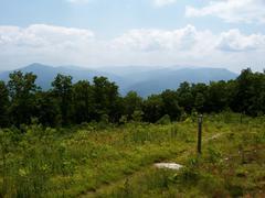 Appalachian Trail Marker Overlooking Smoky Mountains.JPG Stock Photos
