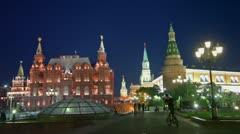 Bicyclist and pedestrians walk by Manezhnaya square near kremlin Stock Footage