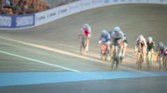 Group of bicyclists ride track during race, unfocused Stock Footage