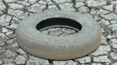 Old tire in dried wetland Stock Footage