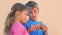 Boy holds model of tall ship and talks with sister Stock Footage