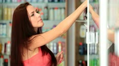 Young Woman Shopping in Cosmetics Department Stock Footage
