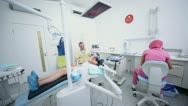 Girl comes out from dental surgery after procedure Stock Footage