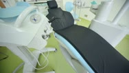 Stock Video Footage of Dental chair and other equipment in surgery, upward motion