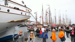 People walk in port of Stavanger on festival-regatta Stock Footage