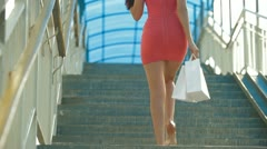 Young Woman Walking with Shopping Bags Stock Footage