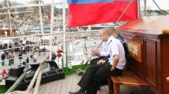 Russian seamen smoke on deck of windjammer Krusenstern Stock Footage