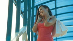 Shopping Woman On The Phone Stock Footage
