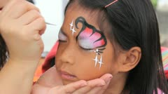 Little Asian Girl Happy With Her Face Paint - stock footage