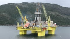 Seagulls fly over drilling platform in gulf of Stavanger Stock Footage