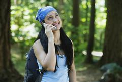 Stock Photo of Hiking woman on mobile phone