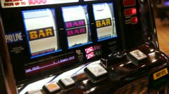 Woman won bar to line hazardously playing in amusement machine Stock Footage