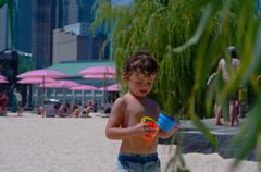 Cute Little Beach Boy In The City - stock photo