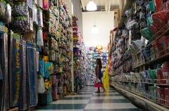 Pretty Little Girl Shopping In A Dollar Store Party Section - stock photo