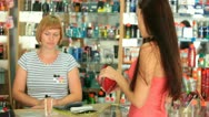 Woman Buying Cosmetics Stock Footage