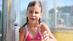 Nice little girl washes under water in shower cabin Stock Footage