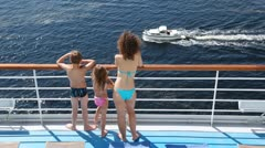 Mother, daughter and son look at powerboat floating nearby Stock Footage