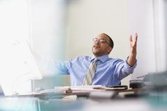 Happy businessman at desk Stock Photos