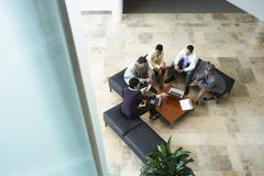 Businesspeople meeting in lobby Stock Photos