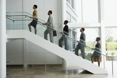 Group of business people climbing stairs Stock Photos