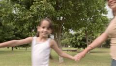 School teacher and children running in circle around the camera Stock Footage