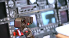 Control lever by helicopter stands against control panel Stock Footage