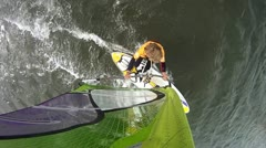 Windsurfer with camera mounting in the mast looking down Stock Footage