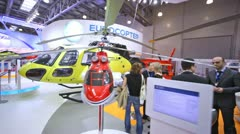 Helicopter UTair stands on International exhibition Stock Footage