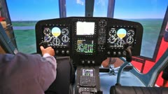 Pilot operates helicopter simulator on exhibition Stock Footage
