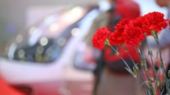 Bouquet of carnations stands against helicopter cabin Stock Footage