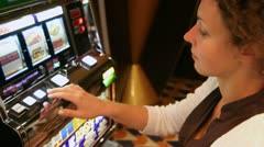 woman presses buttons of slot machine, loses and frowns close up - stock footage