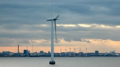 wind generators of electricity on water and ashore - stock footage