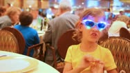 Girl behind table at restaurant wearing spectacles Stock Footage
