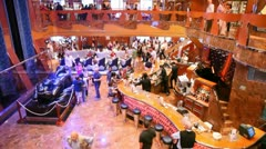 Spacious hall of Costa Luminosa with balcony, full of people Stock Footage