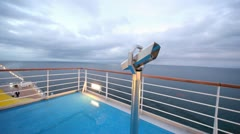 empty main deck with viewing field-glasses and sea in distance - stock footage