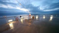Movement on empty ship stern to handrail in evening Stock Footage