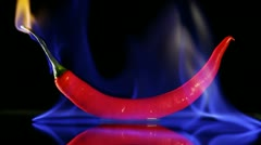 Burning hot Chilli pepper with flame on black Stock Footage