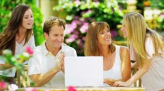 Caucasian Family Wireless Laptop Outdoors - stock footage