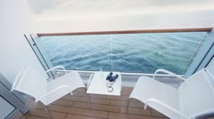 Fenced balcony of deck of ship for two with chairs and table Stock Footage