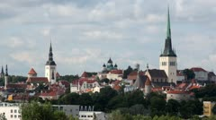 Cityscape of Tallinn with houses, spikes of churches and towers Stock Footage