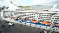 Panorama of huge multideck passenger liner standing in port Stock Footage