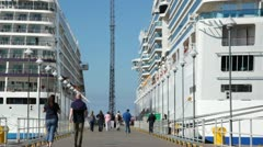 Mooring between two liners on which there are people Stock Footage