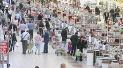 People carry carts with products to cash desk in superstore Stock Footage
