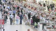 Stock Video Footage of People carry carts with products to cash desk in superstore