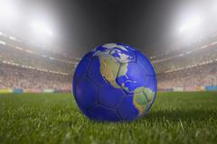 Soccer ball painted like a globe resting on grass in large stadium Stock Illustration