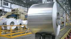 Roll of aluminum moves in production shop of rolling mill - stock footage