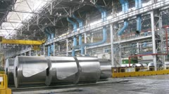 Rolls of aluminum lie in production workshop of plant - stock footage