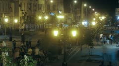Young people sit on benches in evening on Leningradskaya street Stock Footage